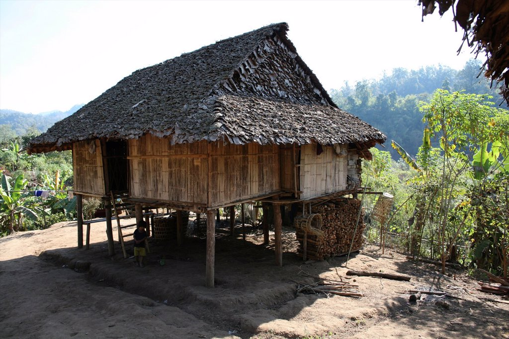 Stock Photo: 1566-978984 A hut in the displaced persons camp near the border with Thailand In Myanmar Burma, thousands of people have settled near the border as a result of oppression in their homeland Around 200 Burmese displaced people have settled in La Per Her, a village on t