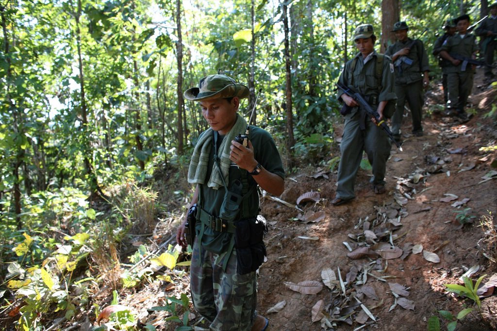 Stock Photo: 1566-978991 KNLA soldiers walking through the jungle near Thailand In Myanmar Burma, thousands of people have settled near the border as a result of oppression in their homeland Around 200 Burmese displaced people have settled in La Per Her, a village on the Burmese