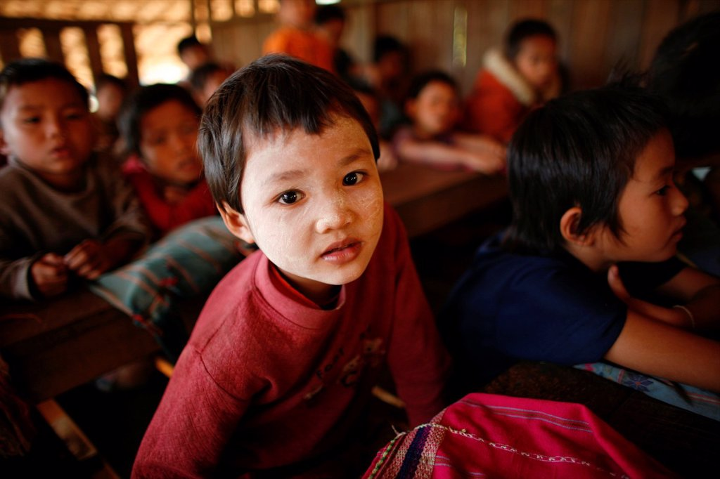 Stock Photo: 1566-978996 Closeup of a child at the La Per Her village school in Myanmar In Myanmar Burma, thousands of people have settled near the border as a result of oppression in their homeland Around 200 Burmese displaced people have settled in La Per Her, a village on the