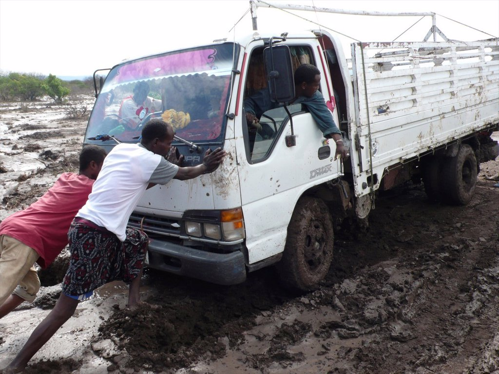 Stock Photo: 1566-979114 The roads are bad in Ethiopia and all the cars get stuck in the mud