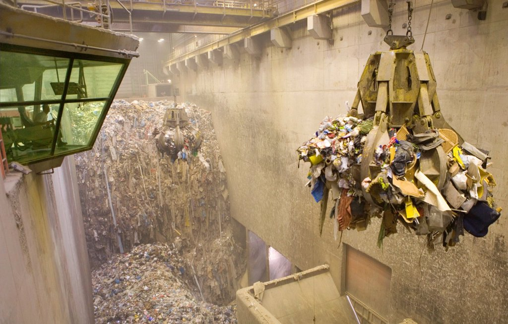 Stock Photo: 1566-979264 The combustor ´Twence´ in The Netherlands is able to process 550,000 tonnes of waste and 150,000 tonnes of biomass annually The majority of waste is being burned in the industrial waste incineration plant AVI in order to generate electricty Through turb. The combustor ´Twence´ in The Netherlands is able to process 550,000 tonnes of waste and 150,000 tonnes of biomass annually The majority of waste is being burned in the industrial waste incineration plant AVI in order to generate electricty