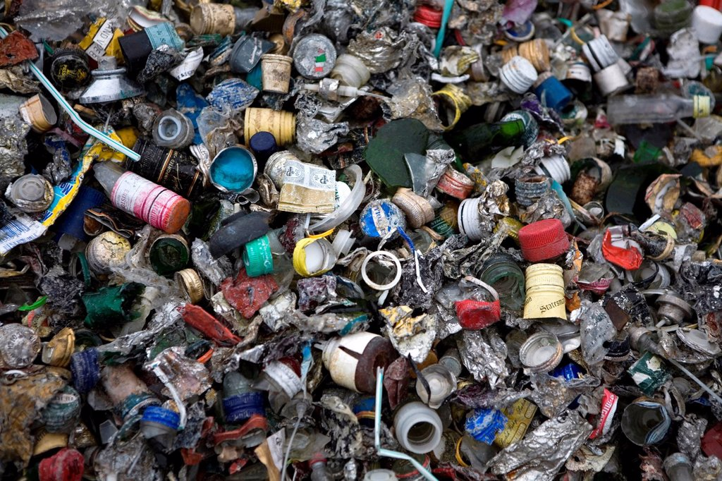 Stock Photo: 1566-979380 Recycling of bottle caps All municipalities in The Netherlands are required to provide known collection points for recyclable and/or hazardous materials All types of separated trash can be accepted here for free or a small sum depending on type of materia