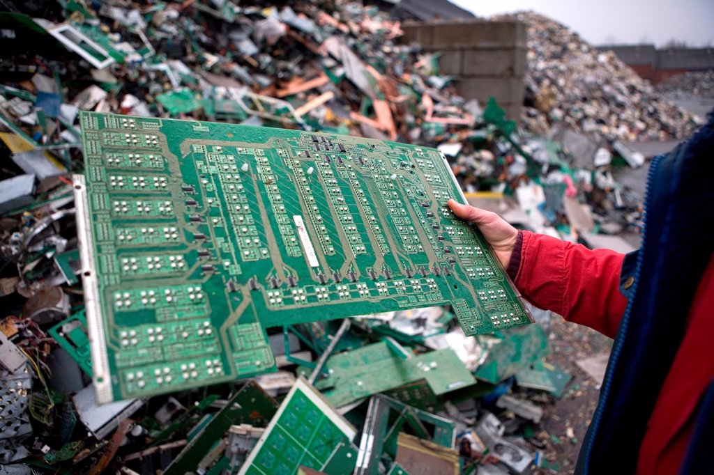 Stock Photo: 1566-979416 Reclycling of computer parts All municipalities in The Netherlands are required to provide known collection points for recyclable and/or hazardous materials All types of separated trash can be accepted here for free or a small sum depending on type of mat