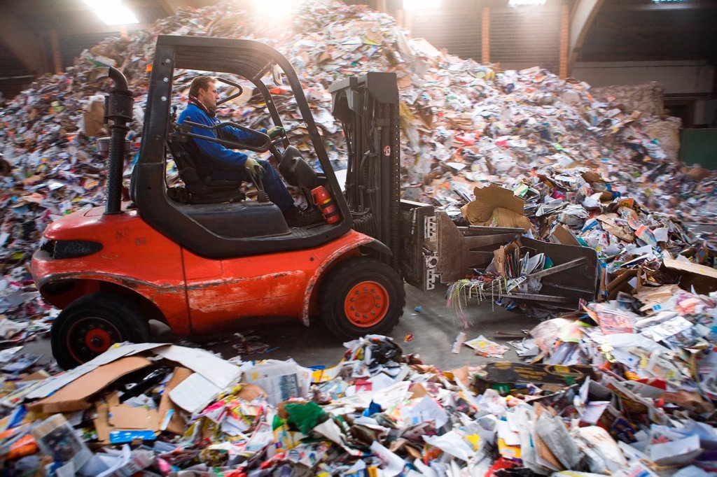 Stock Photo: 1566-979453 Recycling of paper All municipalities in The Netherlands are required to provide known collection points for recyclable and/or hazardous materials All types of separated trash can be accepted here for free or a small sum depending on type of material gree