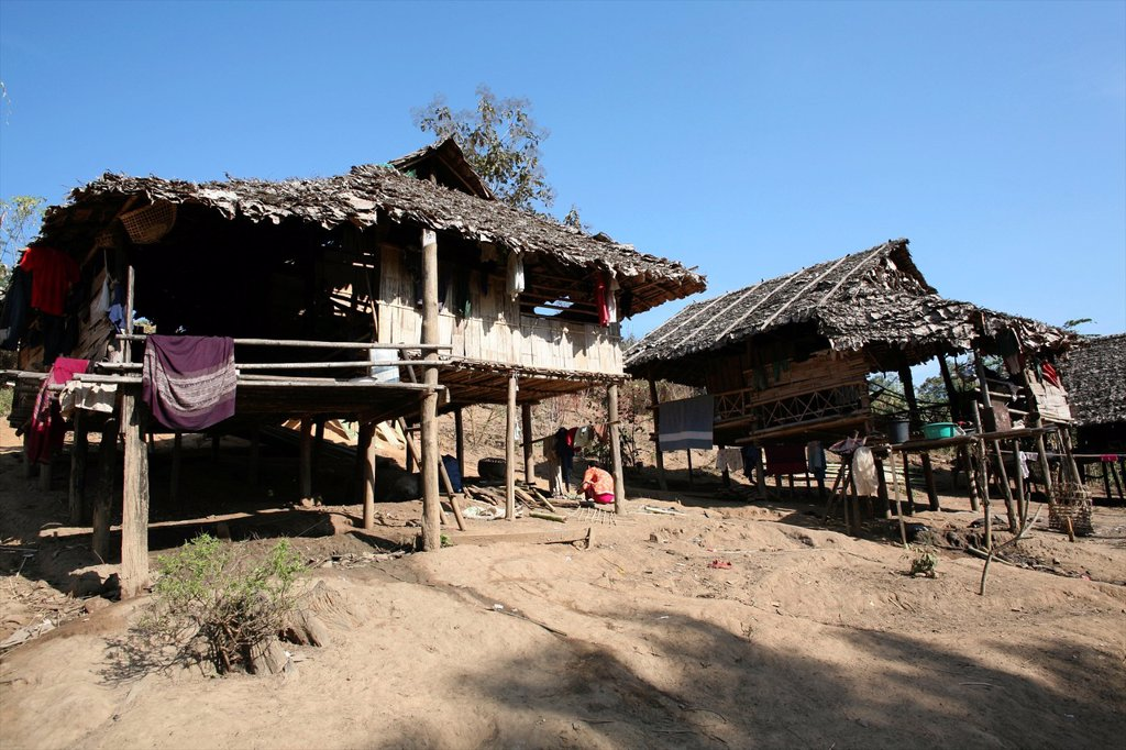 Stock Photo: 1566-979969 View of Burmese huts in the camp near the border with Thailand In Myanmar Burma, thousands of people have settled near the border as a result of oppression in their homeland Around 200 Burmese displaced people have settled in La Per Her, a village on the