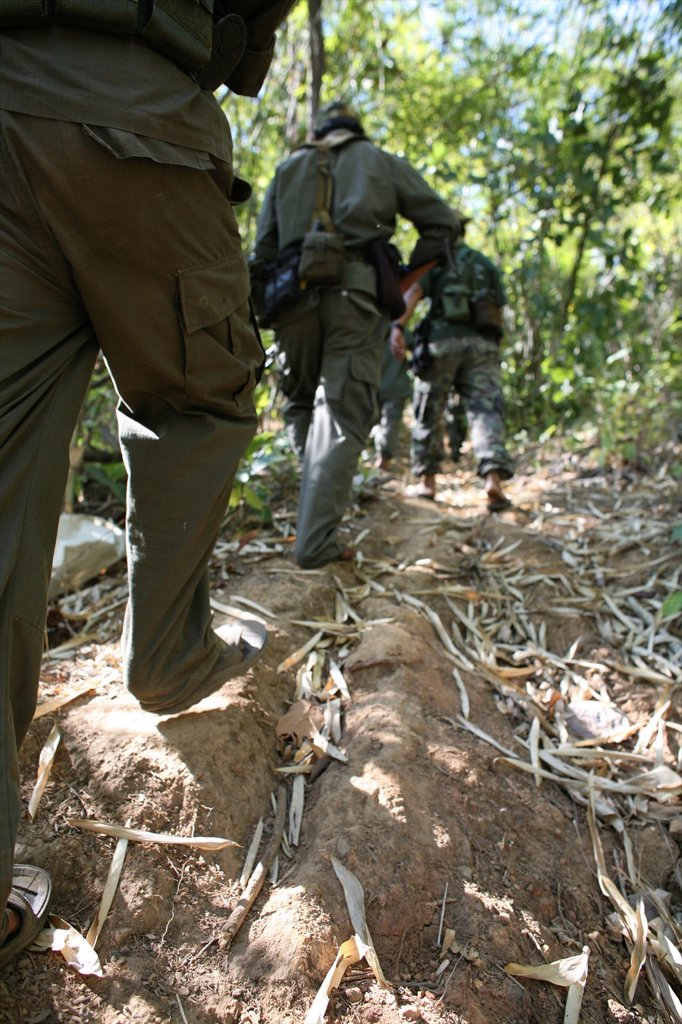 Stock Photo: 1566-979976 Closeup of soldiers´ legs wallking through the jungle near Thailand In Myanmar Burma, thousands of people have settled near the border as a result of oppression in their homeland Around 200 Burmese displaced people have settled in La Per Her, a village o. Closeup of soldiers´ legs wallking through the jungle near Thailand In Myanmar Burma, thousands of people have settled near the border as a result of oppression in their homeland Around 200 Burmese displaced people have settled in La Per Her,