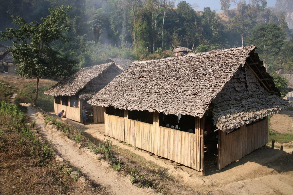 Stock Photo: 1566-980074 Newly constructed houses in Mae Sot camp Around 130,000 Burmese refugees have settled in Thailand due to opression in their homeland of Myanmar Burma Approximately 30,000 refugees now live in Mae Sot western Thailand and receive humanitarian aid Another 2