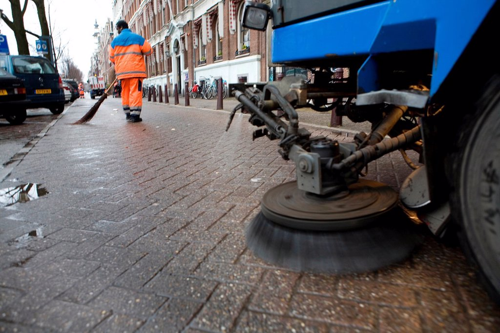 Street cleaners at work in Amsterdam : Stock Photo