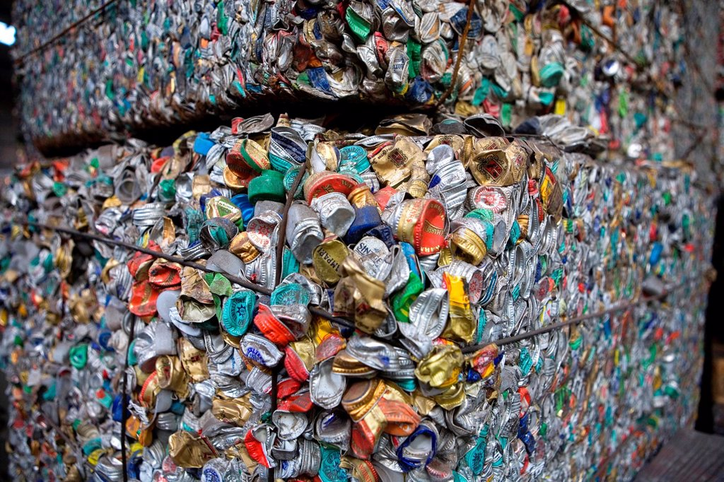 Stock Photo: 1566-980322 Recycling of bottle caps All municipalities in The Netherlands are required to provide known collection points for recyclable and/or hazardous materials All types of separated trash can be accepted here for free or a small sum depending on type of materia