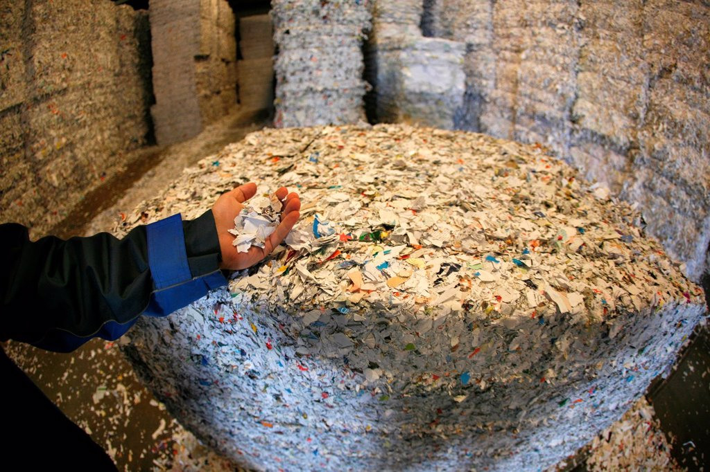 Stock Photo: 1566-980419 Recycling of paper All municipalities in The Netherlands are required to provide known collection points for recyclable and/or hazardous materials All types of separated trash can be accepted here for free or a small sum depending on type of material gree