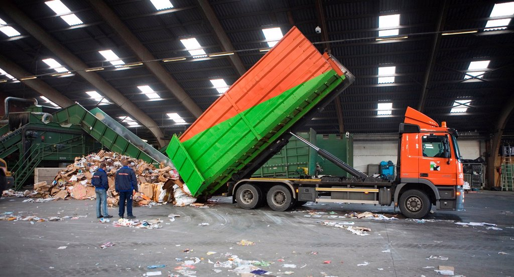 Stock Photo: 1566-980435 Recycling of paper All municipalities in The Netherlands are required to provide known collection points for recyclable and/or hazardous materials All types of separated trash can be accepted here for free or a small sum depending on type of material gree