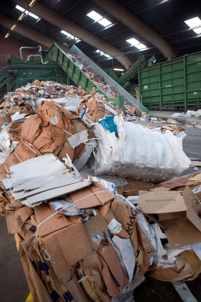 Stock Photo: 1566-980436 Recycling of paper All municipalities in The Netherlands are required to provide known collection points for recyclable and/or hazardous materials All types of separated trash can be accepted here for free or a small sum depending on type of material gree