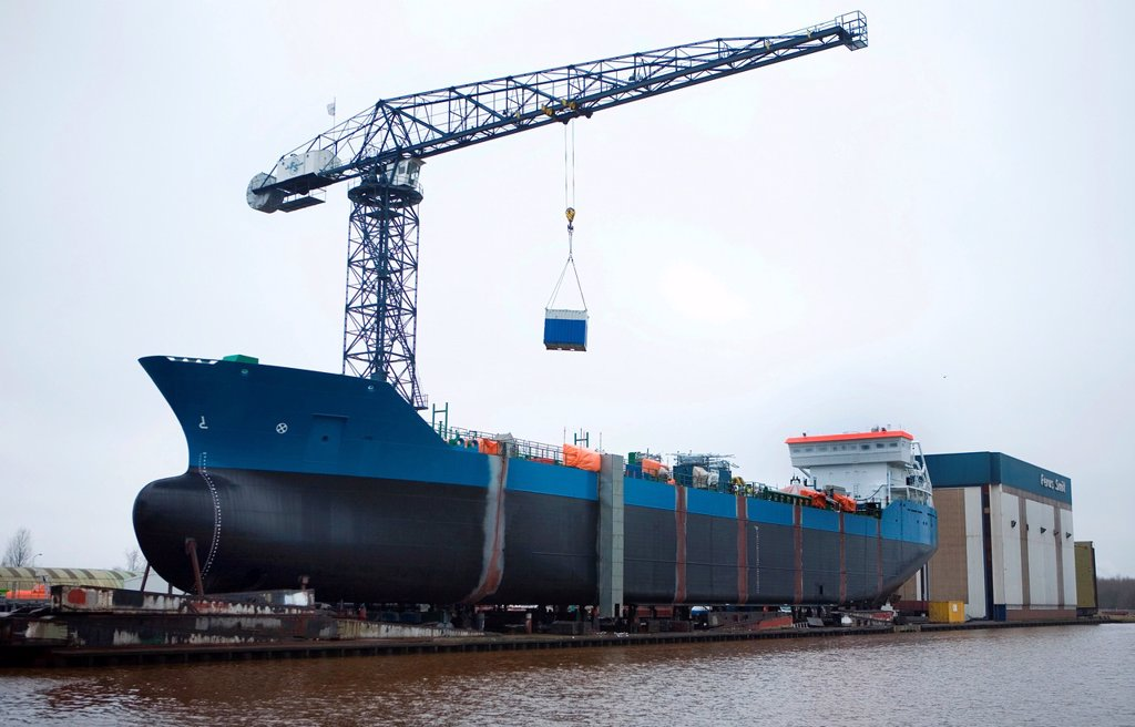Stock Photo: 1566-980501 Construction of a ship at a shipyard has been completed and ready to use Many of the shipyards in Groningen have been bankrupt There are only few remaining from more than 20 yards a couple years ago Most of the ships parts are being made in eastern Europe