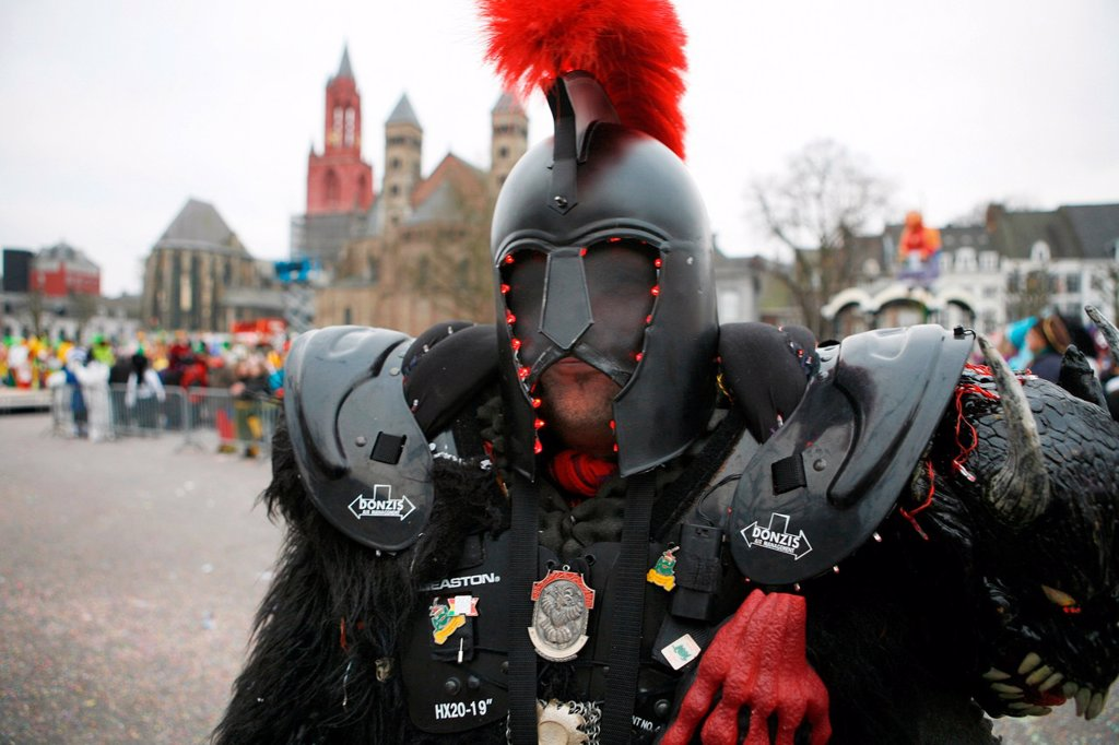 Stock Photo: 1566-981009 Carnival in Maastricht This festival is different then in other parts of Holland as there are around 100 bands playing live fanfara music in the city centre Most of the celebrations take place outside on the streets and squares During three days of celebr