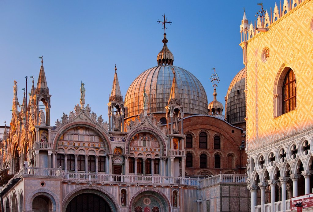 Stock Photo: 1566-981754 Warm glow of the setting sun on the detailed architecture of the Basilica San Marco in Venice, Veneto Italy