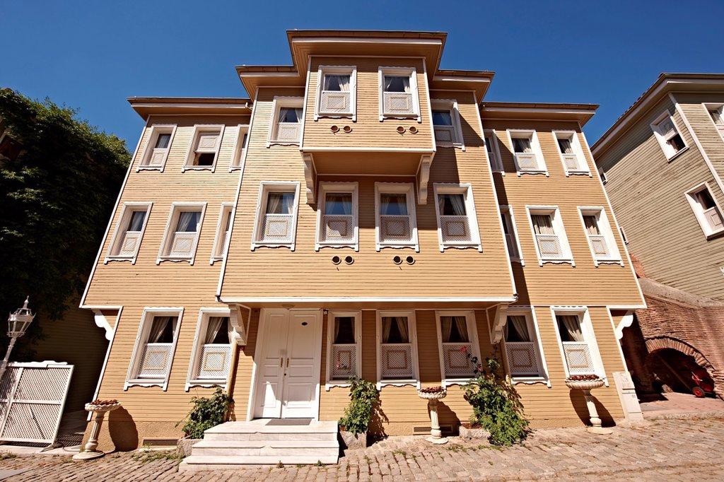 19th century historic Ottoman houses of Sogukçesme Sokagi Street of the Cold Fountain built against the outer wall of the Topkapi Palace once the villas of high officials of the Sultan  Sultanahmet neighborhood Istanbul Turkey : Stock Photo