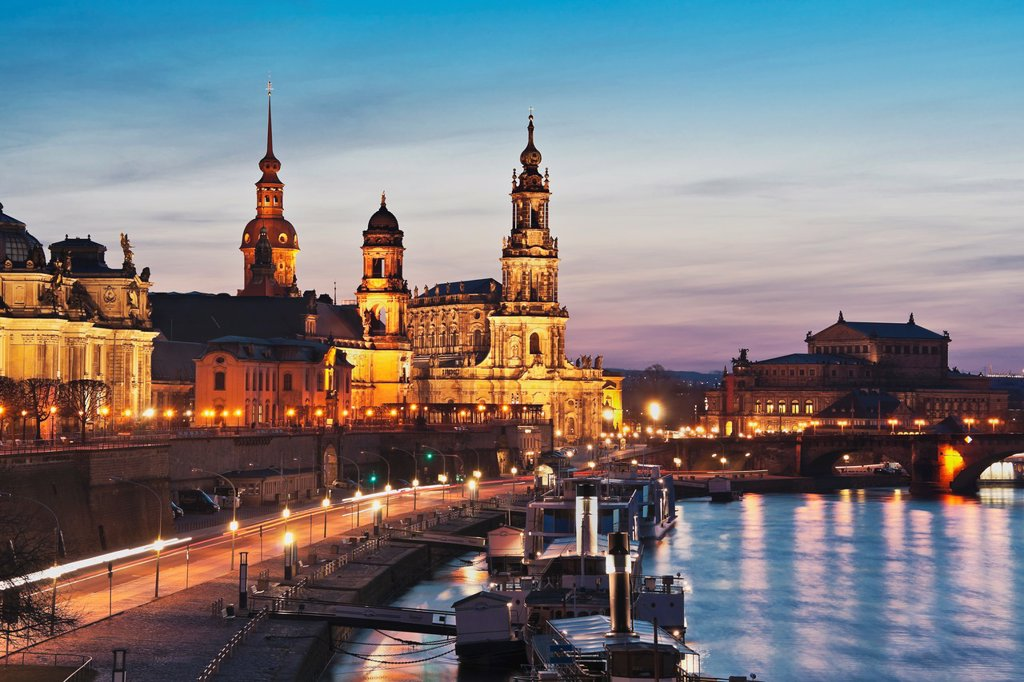 View over Elbe river to Bruehls Terrace, the academy of arts, house of the estates, Hausmannsturm tower, the Catholic Church of the Royal Court of Saxony, the Semper Opera House and Augustus bridge from left to right Dresden, Saxony, Germany, Europe : Stock Photo
