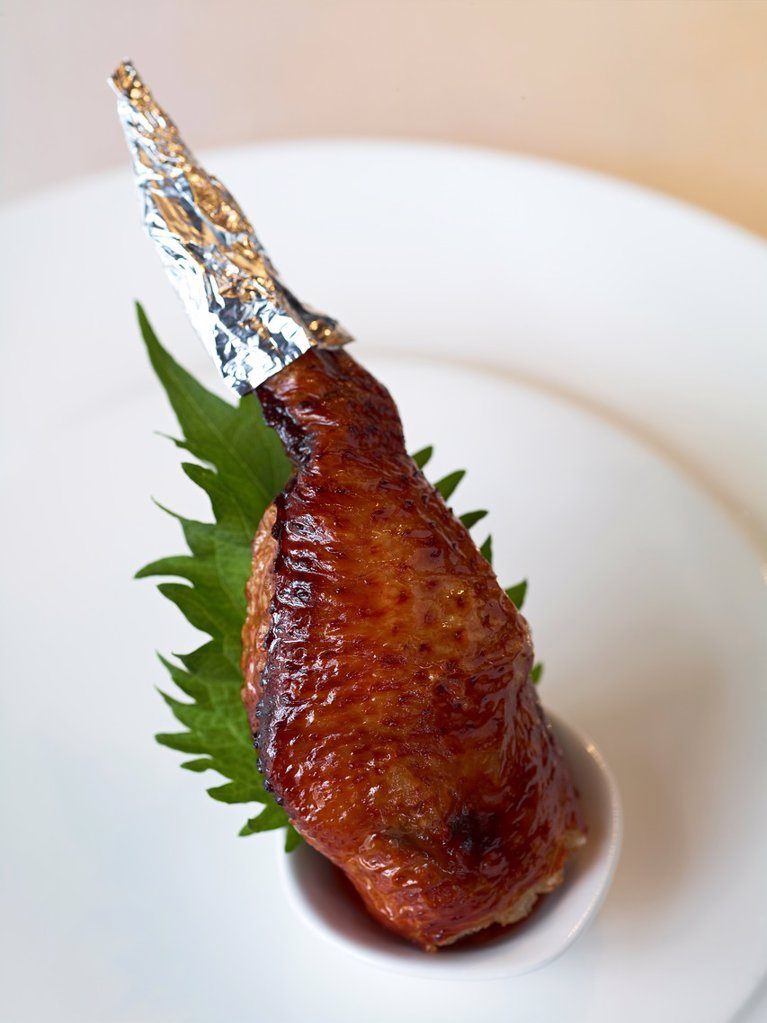 Stock Photo: 1566-984394 A Roasted Chicken wing stuffed with glutinous rice