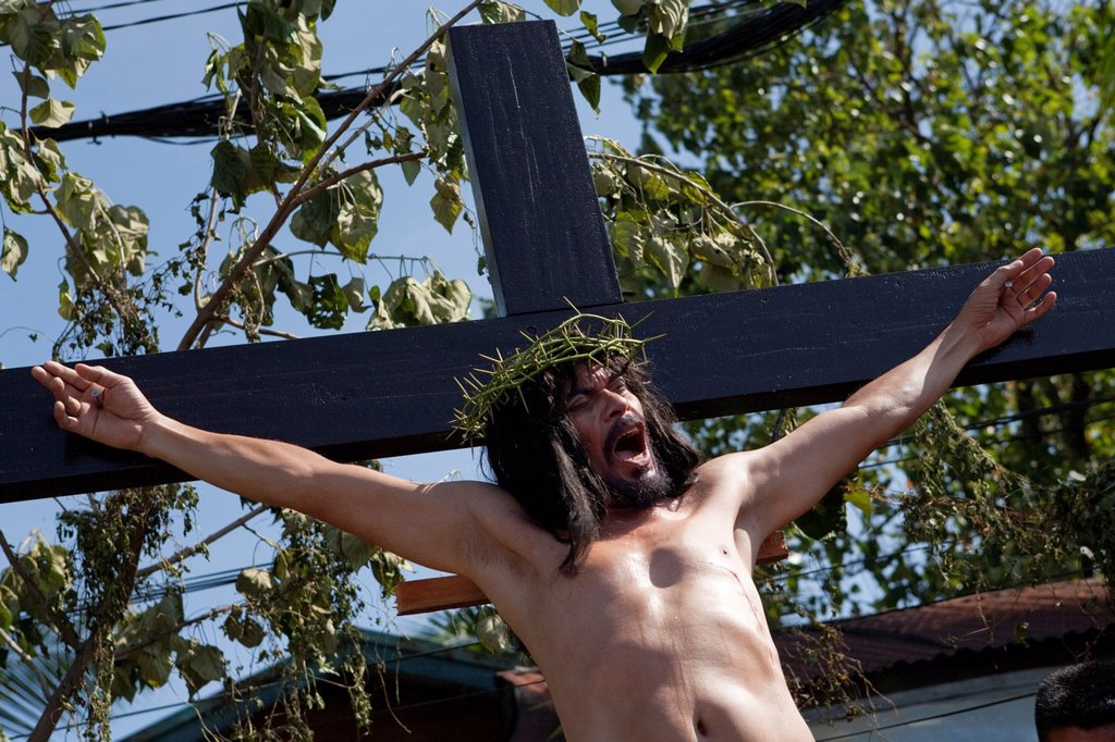 "Stock Photo: 1566-984533 Cebu City, Philippines, Good-Friday, 6 April 2012: Gilbert Bargayo, being nailed to the cross for the 17th Good Friday, with six-inch nails, in Barangay Duljo-Fatima, Cebu City  The nails he uses in his ""crucifixion"" are special: the tips are very sharp t. Cebu City, Philippines, Good-Friday, 6 April 2012: Gilbert Bargayo, being nailed to the cross for the 17th Good Friday, with six-inch nails, in Barangay Duljo-Fatima, Cebu City  The nails he uses in his ""crucifixion"" are special: the tips are"