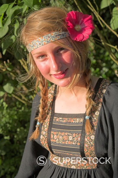 Stock Photo: 1566-985371 Model released image of teenage hippy girl with flower in her hair