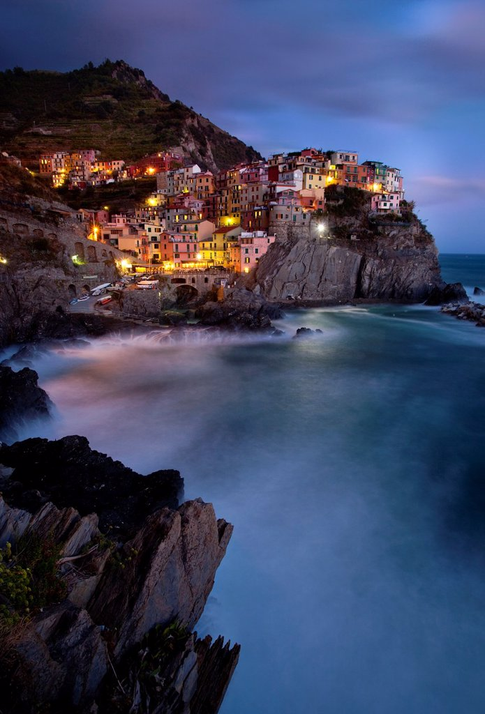 Stock Photo: 1566-986280 The medieval village of Manarola in The Cinque Terre, Liguria Italy