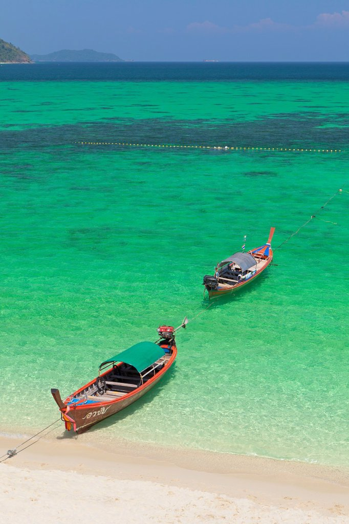 Stock Photo: 1566-987016 Longtail boats on sunrise beach on Ko Lipe island, part of Tarutao national marine park, Thailand