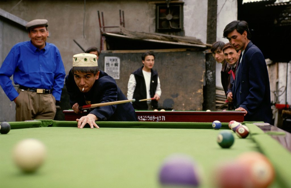 Stock Photo: 1566-987695 Uygur muslims in Beijing, play a game of pool or billiards in the back alley of the old Uygur community in the heart of the city
