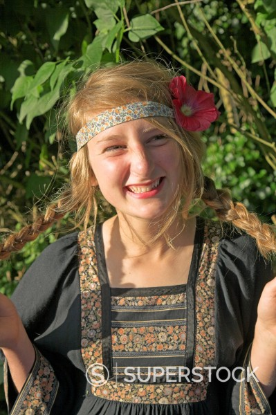 Model released image of teenage hippy girl with flower in her hair : Stock Photo