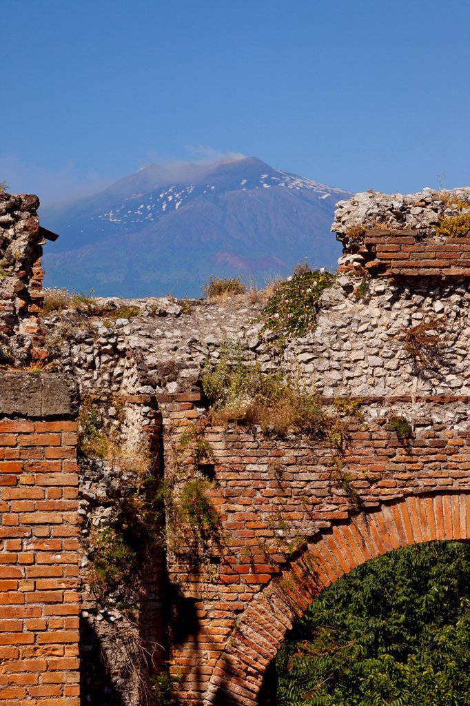 Stock Photo: 1566-989142 Ruins of the Greek Theatre Teatro Greco in Taormina with smoking Mt  Etna beyond, Sicily Italy