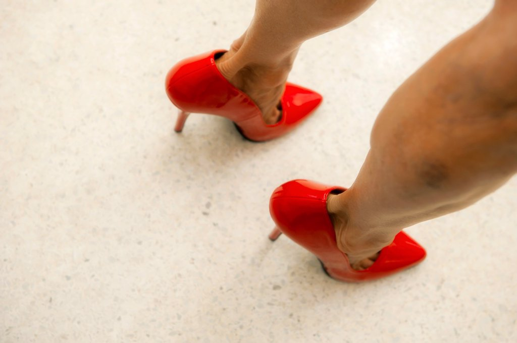 Stock Photo: 1566-990701 Close shot of a woman´s legs with red high heels