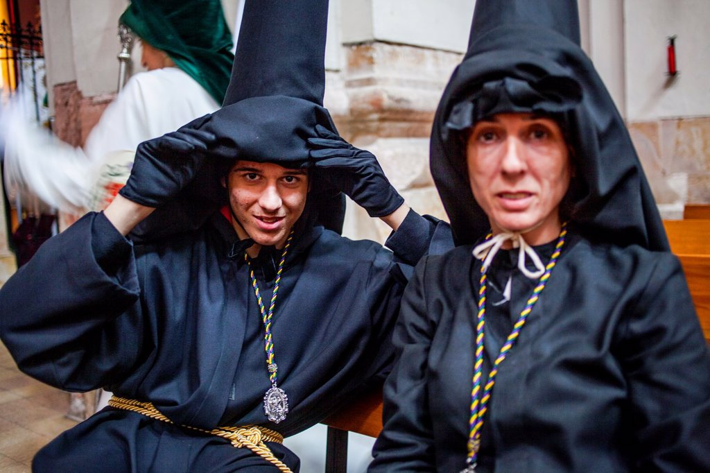 ´Nazarenos´, penitents before starting the procession, in San Agustin church, sisterhood of Jesus del Gran Poder y virgen de la Macarena, Good Friday, Easter week, Plaza de San Agustin, Barcelona, Catalonia, Spain : Stock Photo