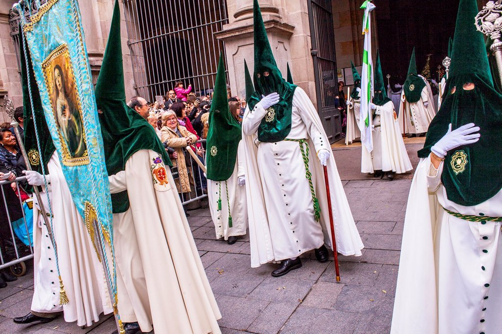 Stock Photo: 1566-991538 Hooded penitents in procession, sisterhood of Jesus del Gran Poder y virgen de la Macarena, Good Friday, Easter week, Plaza de San Agustin, Barcelona, Catalonia, Spain