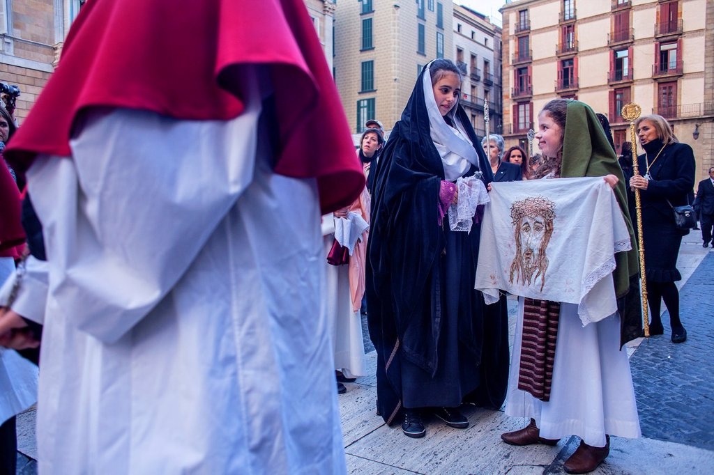Stock Photo: 1566-992083 Penitents in procession, sisterhood of Virgen de las Angustias,Good Friday, Easter week,plaza Sant Jaume,Barcelona, Catalonia, Spain