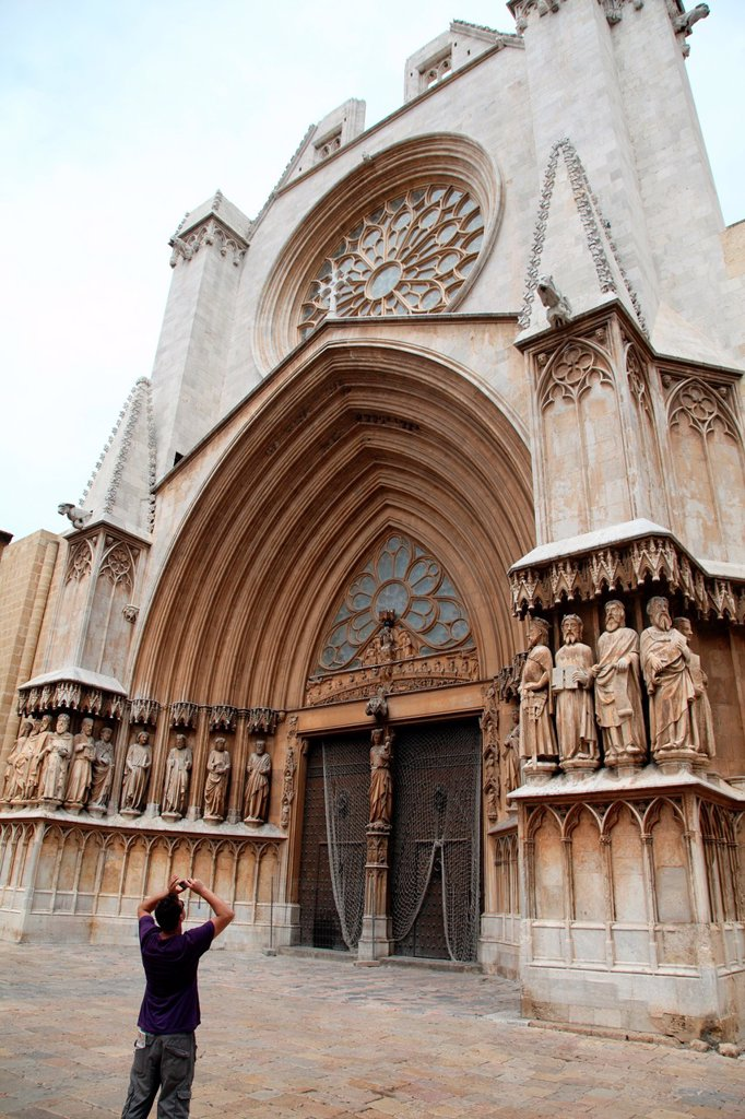 Tourist photographing the facade of the Cathedral of Tarragona, Spain, Europe : Stock Photo