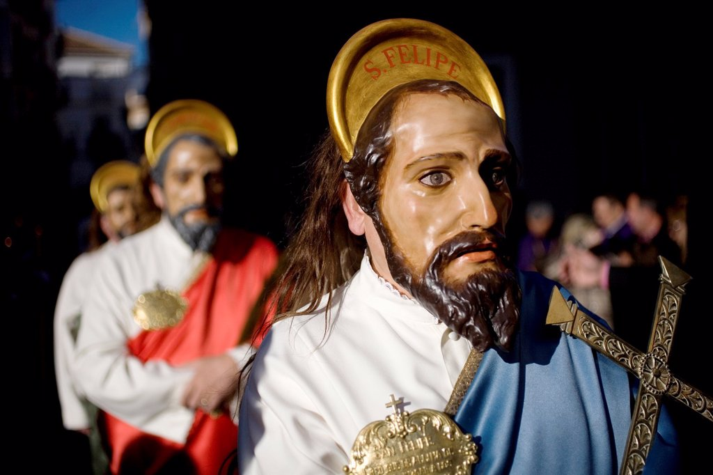 Stock Photo: 1566-993975 A masked man dressed as a biblical character holds a relic during an Easter Holy Week procession in Puente Genil, in the province of Cordoba, Andalusia, Spain.