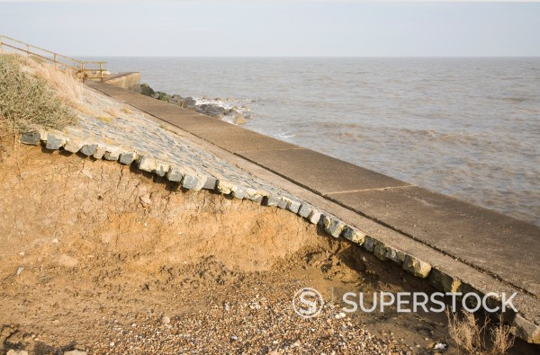 Stock Photo: 1566-994794 Coastal defence sea wall being eroded through scouring of backwash, East Lane, Bawdsey, Suffolk, England