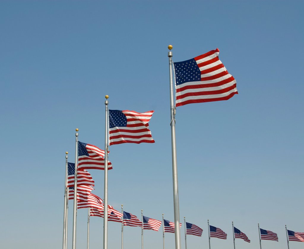 Stock Photo: 1566-995101 Washington DC USA, American flags at the Washington Monument.