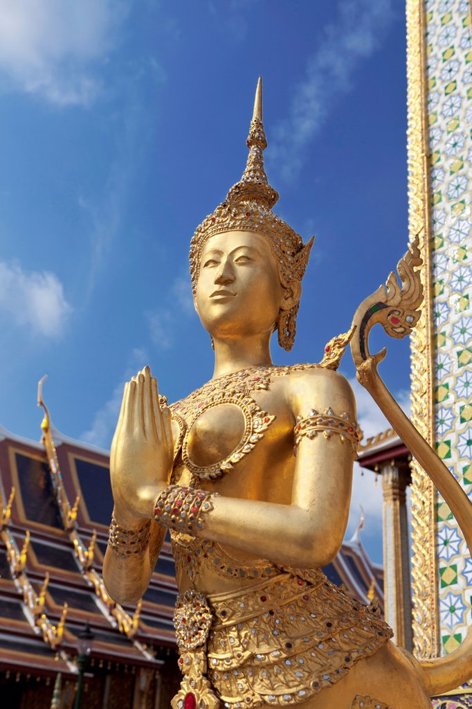 Stock Photo: 1566-996429 Statue of Kinnari, traditional symbol of feminine beauty at Wat Phra Kaeo, the Royal Grand Palace, Bangkok,Thailand