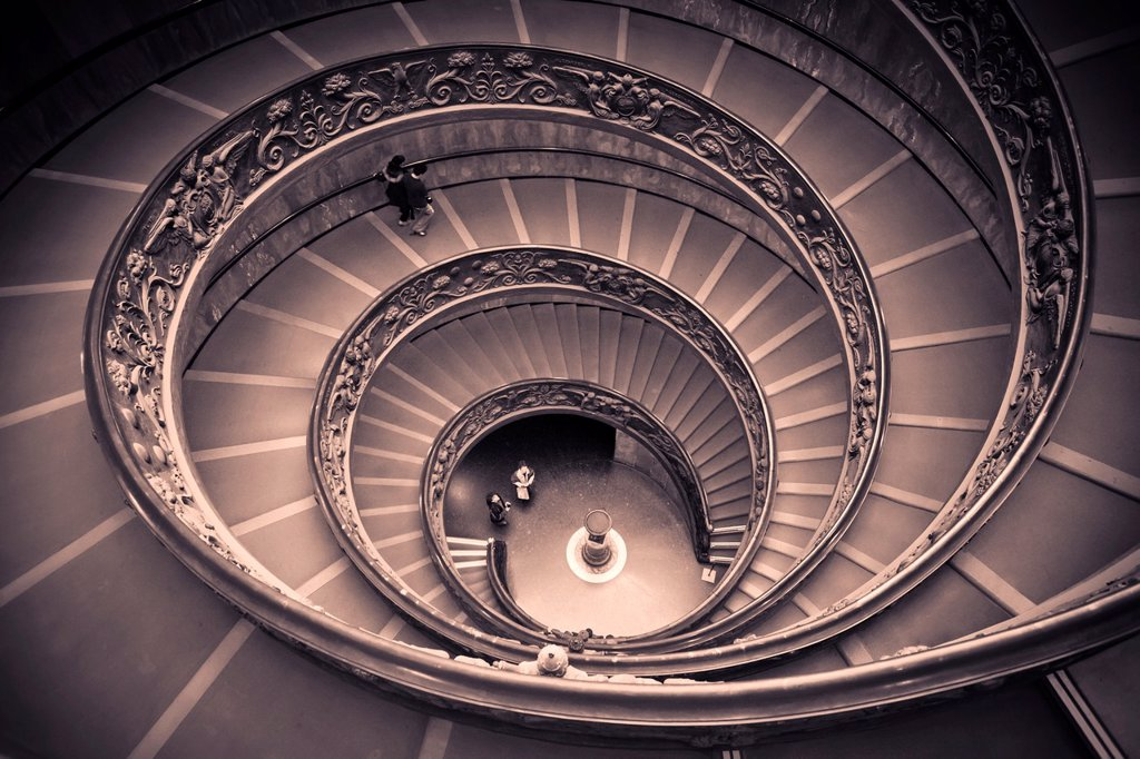Spiral staircase by Giuseppe Momo leading to main floor of Vatican Museum, Rome, Italy : Stock Photo