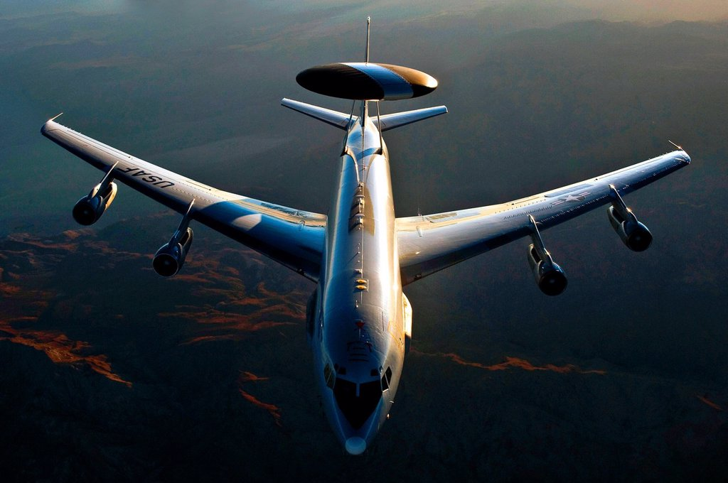 Stock Photo: 1566-996634 An E-3 Sentry flies over the National Training Center at Fort Irwin, Calif , Aug  16, 2011, during Green Flag-West 11-9  The E-3 is assigned to the 965th Airborne Air Control Squadron at Tinker Air Force Base, Okla