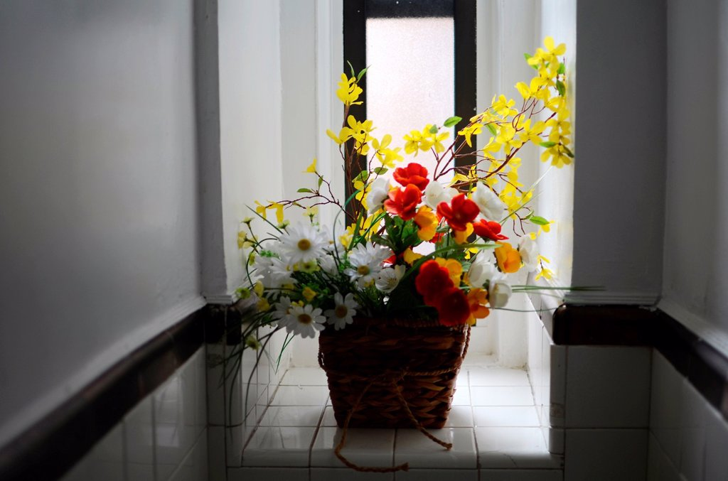 Plastic flowers in house restroom : Stock Photo