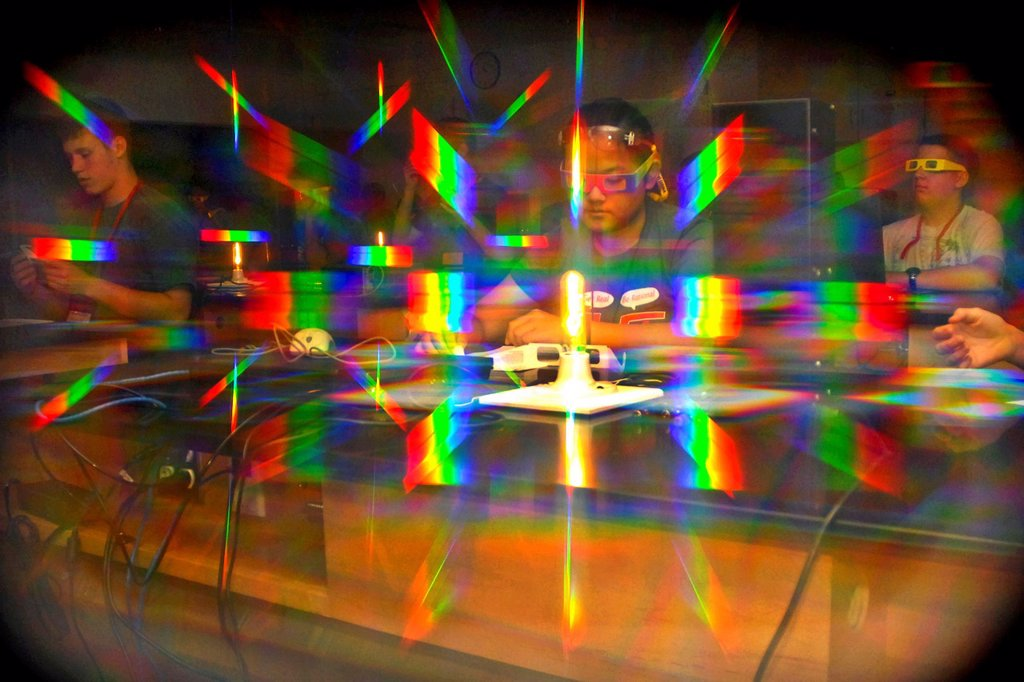 Stock Photo: 1566-997937 110615-N-OA833-002 ANNAPOLIS, Md  June 15, 2011 Seen through the lens of light-diffracting glasses, students participating in the annual Science, Technology, Engineering and Mathematics STEM program at the U S  Naval Academy participate in the atomic fing. 110615-N-OA833-002 ANNAPOLIS, Md  June 15, 2011 Seen through the lens of light-diffracting glasses, students participating in the annual Science, Technology, Engineering and Mathematics STEM program at the U S  Naval Academy participate in the