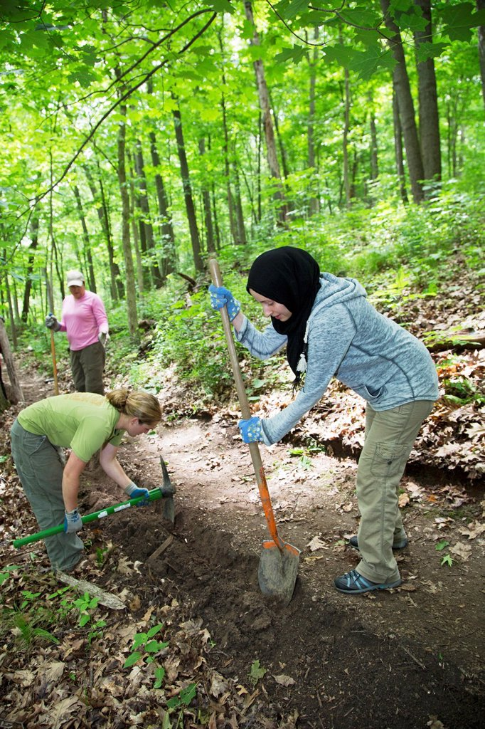 Stock Photo: 1566-997982 Ann Arbor, Michigan - Volunteers rebuild a section of a hiking trail in Black Pond Woods  The volunteers were recruited through Recreational Equipment Inc  REI in cooperation with Ann Arbor´s Natural Area Preservation  It was one of many volunteer project. Ann Arbor, Michigan - Volunteers rebuild a section of a hiking trail in Black Pond Woods  The volunteers were recruited through Recreational Equipment Inc  REI in cooperation with Ann Arbor´s Natural Area Preservation  It was one of many volun