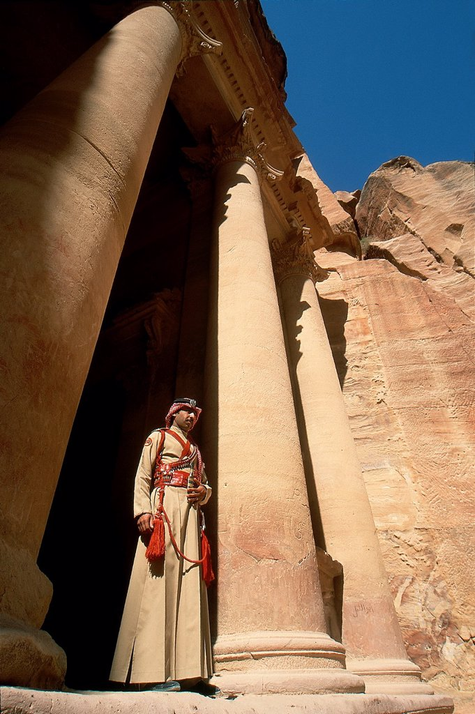 Stock Photo: 1566-998010 guard in costume of Al Khazneh or The Treasury, one of the most elaborate buildings of the ancient city of Petra, Jordan, Middle East, Asia