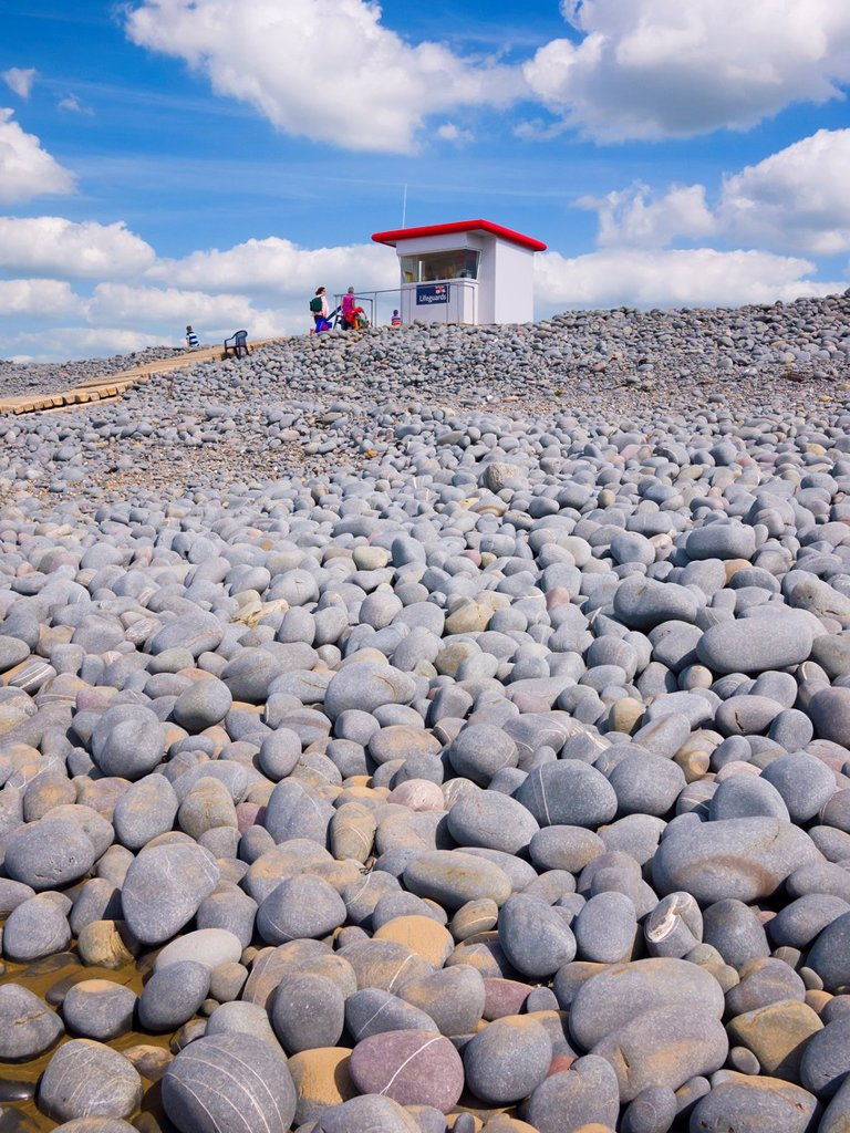 Stock Photo: 1566-999683 A lifeguard lookout hut on the top of the pebble ridge at Westward Ho!, Devon, England, United Kingdom