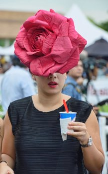 5d0eb72c1ae Panama hat seller at the King s Cup Polo Tournament in Bangkok ...