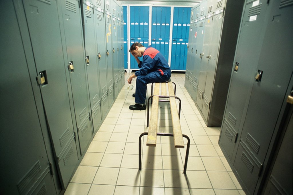 Manual worker in locker room : Stock Photo