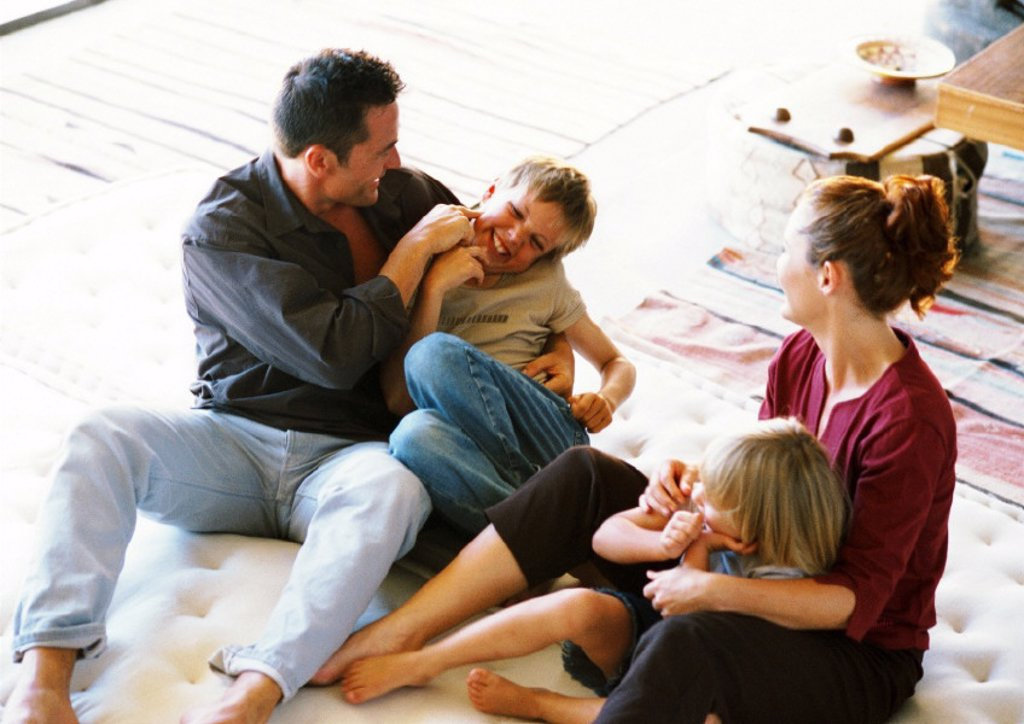 Parents and children playing : Stock Photo