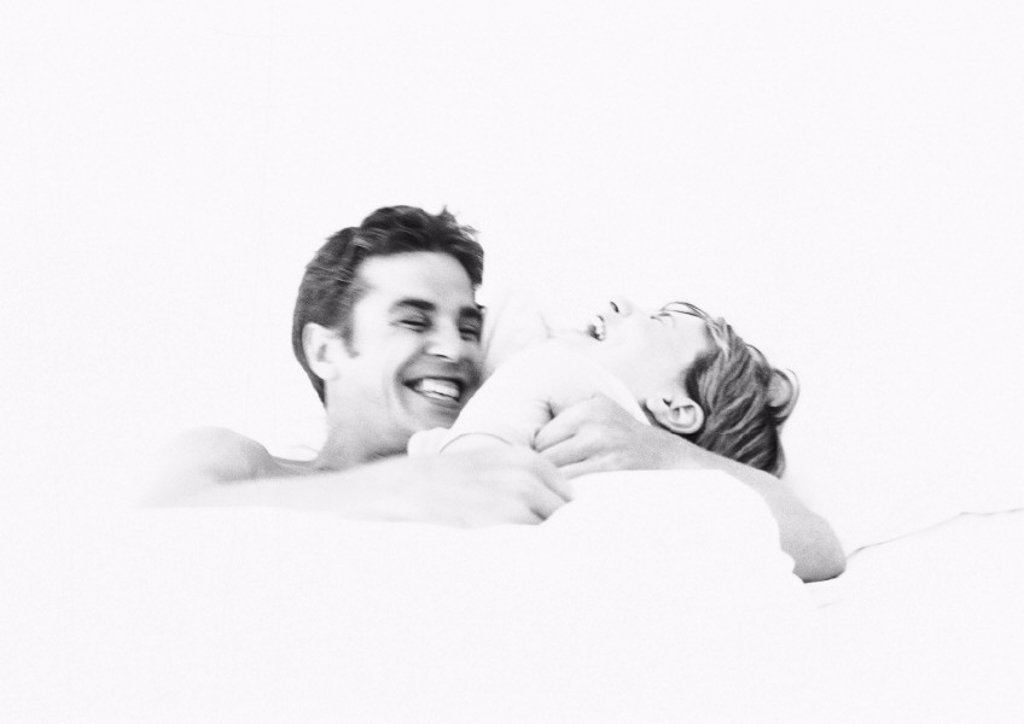 Stock Photo: 1569R-119051 Couple laughing, b&w