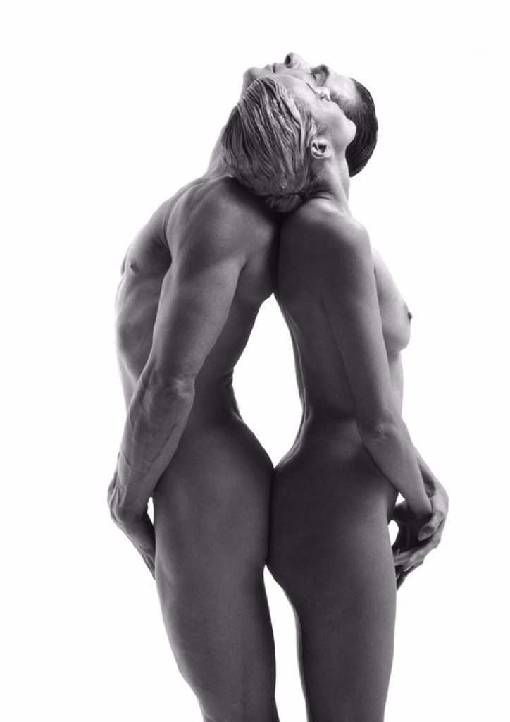 Nude man and woman standing back to back, leaning head back on each others shoulders, side view, b&w : Stock Photo